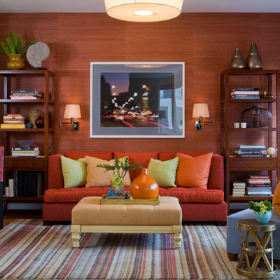 Trendy family room photo in New York with orange walls