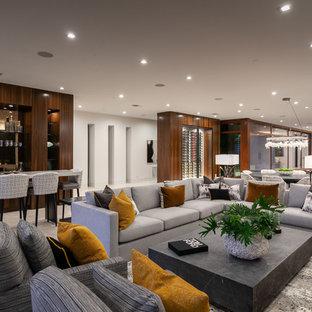Exempel på ett mycket stort modernt allrum med öppen planlösning, med en hemmabar, vita väggar, marmorgolv och beiget golv