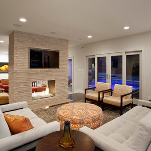 Inspiration for a contemporary family room remodel in Austin with a two-sided fireplace