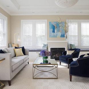 サンフランシスコの広いトランジショナルスタイルのおしゃれなオープンリビング (ベージュの壁、標準型暖炉、セラミックタイルの床、漆喰の暖炉まわり、テレビなし、ベージュの床) の写真