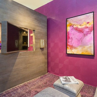 Trendy carpeted family room photo in New York with pink walls