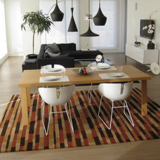 Modern Family Room Coordinating Rugs in Portland condo