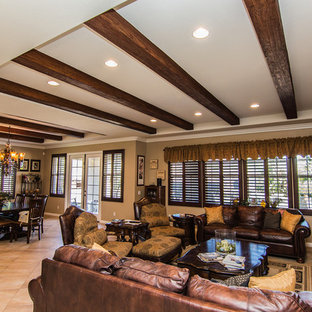 Large elegant loft-style travertine floor family room photo in Los Angeles with beige walls, a standard fireplace and a wood fireplace surround