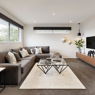 Contemporary family room in Melbourne with white walls, carpet, no fireplace and a wall-mounted tv.