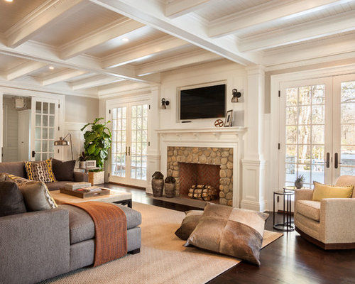 Family room - mid-sized traditional enclosed dark wood floor family room  idea in New