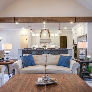 Ejemplo de sala de juegos en casa abierta, campestre, grande, con paredes grises, suelo de madera oscura, chimenea tradicional, marco de chimenea de piedra y televisor colgado en la pared