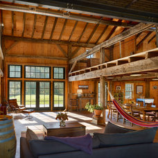 Rustic Family Room by Pinneo Construction