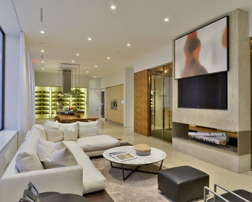 Inspiration for a contemporary open concept family room remodel in New York  with white walls,