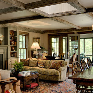 Inspiration for a timeless open concept family room remodel in New York with beige walls and a standard fireplace