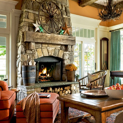 Inspiration for a timeless family room remodel in New York with orange walls and a stone fireplace