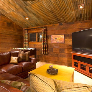 Example of a mountain style carpeted family room design in Portland with brown walls and a tv stand