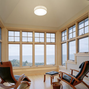 Family room - contemporary light wood floor family room idea in Boston with beige walls