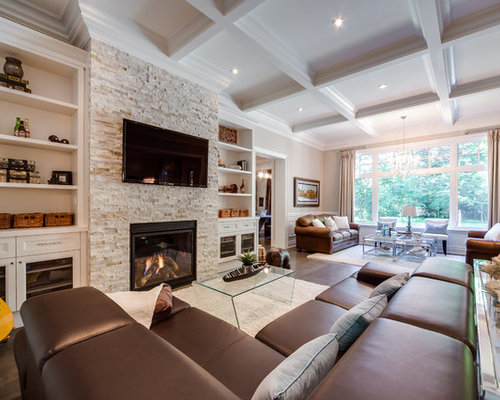 Large elegant open concept family room photo in Toronto with a stone  fireplace surround  beige. Best Traditional Family Room Design Ideas   Remodel Pictures   Houzz