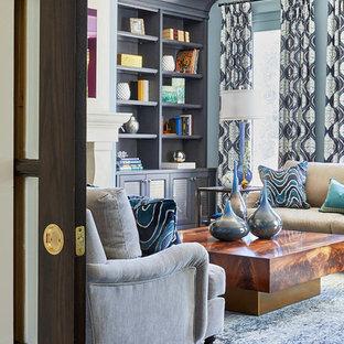 トロントの中サイズのトランジショナルスタイルのおしゃれな独立型ファミリールーム (標準型暖炉、石材の暖炉まわり、青い壁、カーペット敷き、テレビなし、青い床) の写真