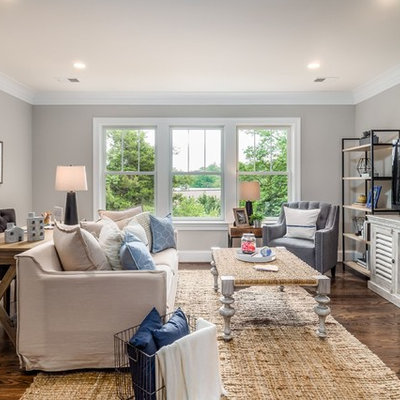 Inspiration for a large craftsman open concept dark wood floor and brown floor family room remodel in DC Metro with gray walls, no fireplace and a tv stand