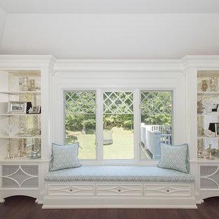 ニューヨークの中サイズのトランジショナルスタイルのおしゃれなロフトリビング (ライブラリー、標準型暖炉、石材の暖炉まわり、壁掛け型テレビ、茶色い床、青い壁、ラミネートの床) の写真