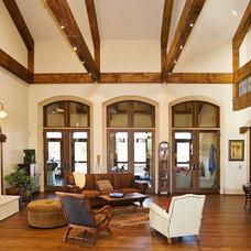 Mediterranean Family Room by Carpenter Construction, Inc.