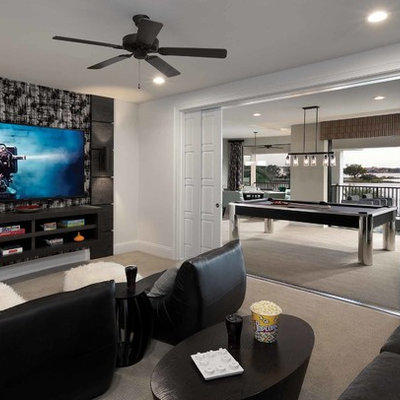 Example of a mid-sized trendy open concept carpeted game room design in Orlando with white walls, no fireplace and a wall-mounted tv
