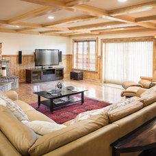 Rustic Family Room by Katahdin Cedar Log Homes