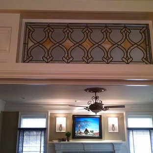 Custom Transom with millwork and original 1908 stained glass.