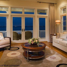 Mediterranean Family Room by Clifford M. Scholz Architects Inc.