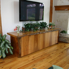 Tropical Home Theater by Carson's Cabinetry & Design