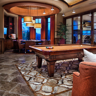 Example of a tuscan open concept marble floor and gray floor game room design in Dallas with beige walls