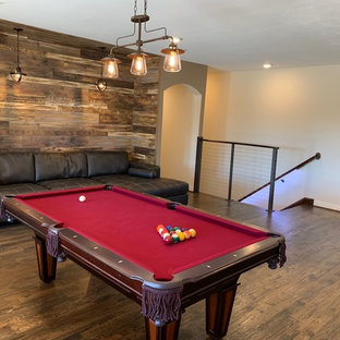 Inspiration for a large modern open concept dark wood floor and brown floor game room remodel in Dallas with beige walls and a wall-mounted tv