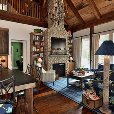 Rustic Family Room by Blansfield Builders, Inc.