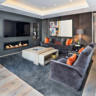 Inspiration for a mid-sized modern enclosed light wood floor and beige floor family room remodel in Phoenix with brown walls, a ribbon fireplace, a metal fireplace and a media wall