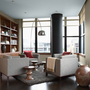 Example of a trendy open concept dark wood floor and brown floor family room design in Minneapolis with beige walls, no fireplace and no tv