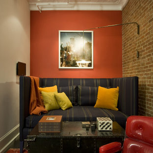 Inspiration for an industrial family room remodel in New York with orange walls