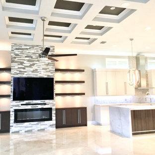 Idée de décoration pour une grand salle de séjour minimaliste ouverte avec un mur gris, un sol en marbre, cheminée suspendue, un manteau de cheminée en pierre de parement, un téléviseur fixé au mur, un sol beige et un plafond à caissons.