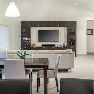 Example of a mid-sized minimalist open concept porcelain floor family room design in Miami with a bar, white walls and a wall-mounted tv