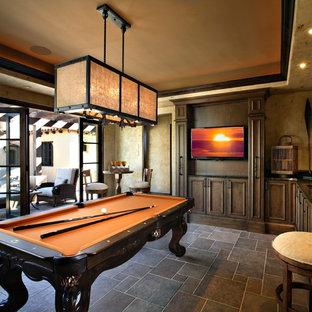 Idées déco pour une grande salle de séjour classique fermée avec salle de jeu, un mur beige, un téléviseur fixé au mur, un sol en ardoise, aucune cheminée et un sol gris.