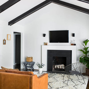 1950s open concept dark wood floor family room photo in Atlanta with gray walls, a standard fireplace, a stone fireplace and a wall-mounted tv