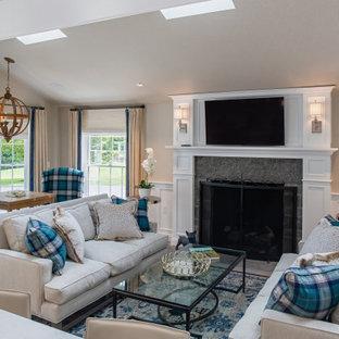 Идея дизайна: открытая гостиная комната среднего размера в морском стиле с серыми стенами, паркетным полом среднего тона, стандартным камином, фасадом камина из камня, телевизором на стене, коричневым полом, потолком с обоями и обоями на стенах
