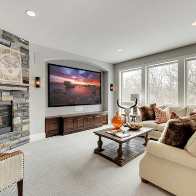Inspiration for a timeless carpeted family room remodel in Minneapolis with gray walls, a corner fireplace and a wall-mounted tv