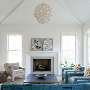 Country family room photo in Charleston with white walls, a standard fireplace and a media wall