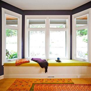 Minimalist light wood floor family room photo in Bridgeport with purple walls