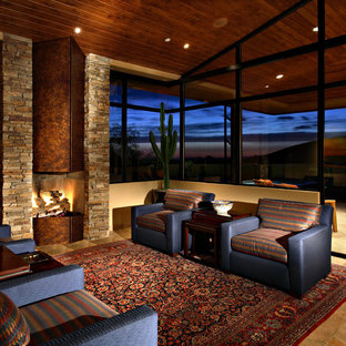 Trendy family room photo in Los Angeles with beige walls, a standard fireplace and a metal fireplace