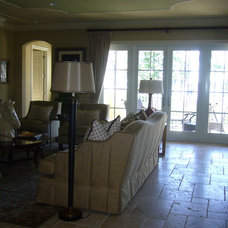 Traditional Family Room by Vallos Interiors