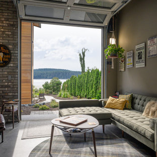 Urban concrete floor and gray floor family room photo in Seattle with gray walls