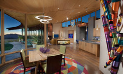 Dining area with a view and colorful art and area rug