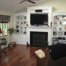 Traditional Family Room by Rettinger Fireplace Systems Inc