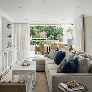 1a4a81ef81f Family room - beach style open concept family room idea in Los Angeles with  beige walls