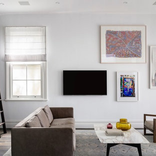 Photo of a contemporary family room in Sydney with white walls, dark hardwood floors, a wall-mounted tv and brown floor.