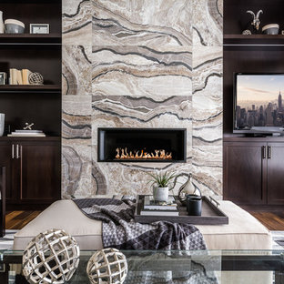 Family room - mid-sized transitional enclosed dark wood floor family room idea in Calgary with gray walls, a ribbon fireplace, a media wall and a tile fireplace