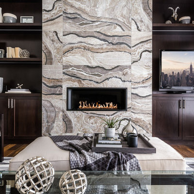 Family room library - mid-sized transitional enclosed dark wood floor family room library idea in Calgary with gray walls, a ribbon fireplace, a media wall and a tile fireplace