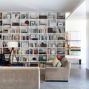 Family room library - mid-sized contemporary open concept concrete floor family room library idea in Little Rock with white walls